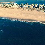 drone photo of house, beach, dune rd., barrier island