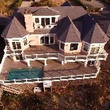 incredible drone view of back of house, facing ocean